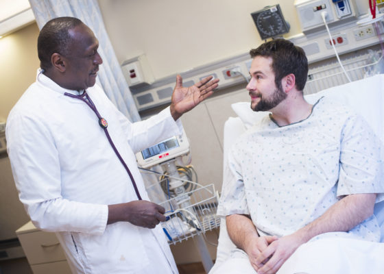 Doctor communicating with patient