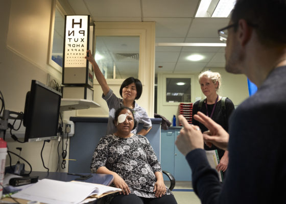 Deaf woman having her vision checked